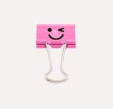 Rosa Lächelnmappenclip lokalisiert auf weißem Hintergrund Stockfotografie