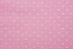 Rosa Material mit Punkten, ein Hintergrund Stockfotografie