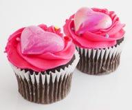 Rosa muffiner Arkivfoto
