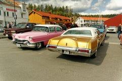 Rosa och guld- bilar royaltyfri fotografi