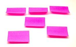 Rosa paper anmärkningar. Arkivbilder