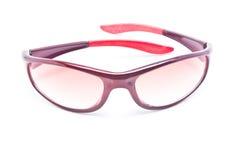 Rosa plast- solglasögon för kvinnor. Arkivbild