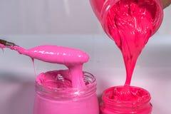 rosa Plastikfarbe und Pinkfarbe stockfotografie