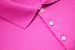 Rosa poloT-tröja Arkivbild