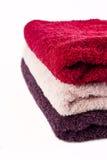 rosa purpura röda handdukar Arkivbild