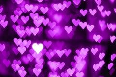 Rosa purpurfärgad violett bakgrund för hjärtabokehabstrakt begrepp royaltyfri foto