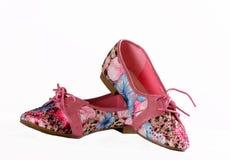 Rosa Schuhe auf einem weißen Hintergrund Stockfotos
