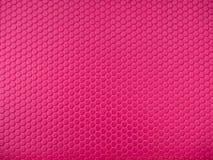 Rosa sexhörningsyttersidabakgrund som bakgrund kan plastic texturbruk Royaltyfri Bild