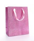 Rosa shopping hänger lös Arkivfoton