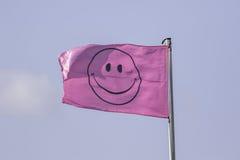 Rosa smileyframsidaflagga Arkivfoton
