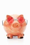 Rosa Sparschwein mit rosaroter Brille, weisser Untergrund, Studi Stock Image