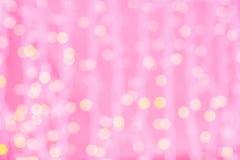 Rosa suddig bakgrund med bokehljus Arkivbilder
