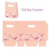 Rosa Taschenschablone mit Herzen und Punkten Stockbilder