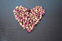 Rosa te i form av hjärta fotografering för bildbyråer