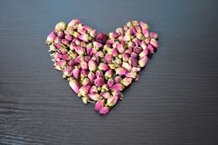 Rosa Tee in Form von Herzen Stockbild
