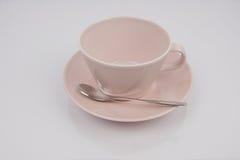 Rosa tekopp, rosa uppläggningsfat Royaltyfria Foton