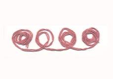 rosa tråd Arkivfoton