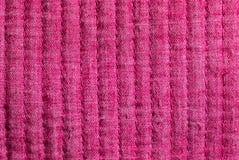 Rosa tyg som på längden sys Arkivbild