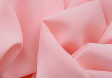 Rosa tyg texturerar bakgrund, ojämnt tyg Arkivbilder