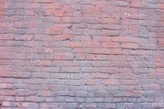 Rosa und Purpur gemalte alte Backsteinmauer Lizenzfreies Stockfoto