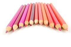Rosa und rote farbige Bleistifte Lizenzfreie Stockfotografie