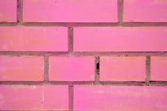 rosa vägg för tegelsten Arkivfoto