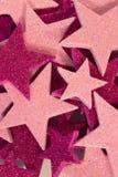 Rosa y fondo púrpura de las estrellas del brillo Fotos de archivo
