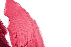 Rosa y lápiz labial manchado púrpura imagen de archivo libre de regalías