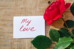 Rosa y notas del rojo mi amor Imagenes de archivo