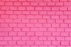 Rosafarbene Backsteinmauer Stockbilder