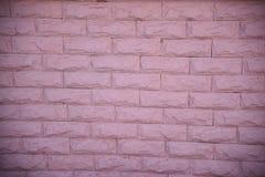 Rosafarbene Backsteinmauer Stockfotografie