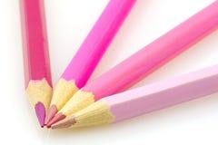 Rosafarbene Bleistifte getrennt Stockfotografie