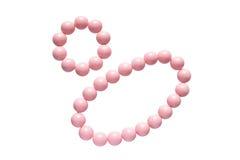 Rosafarbene Halskette und Armband Stockfotografie