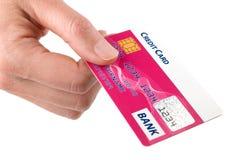 Rosafarbene Kreditkarte Stockfoto
