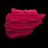 Rosafarbene Lippenstift-Schmierstelle Stockbild