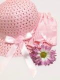 Rosafarbene Ostern-Mütze und Handschuhe Stockbild