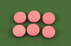 Rosafarbene Pillen Stockbild