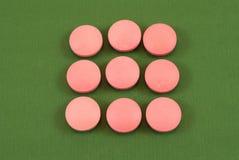 Rosafarbene Pillen Lizenzfreie Stockbilder