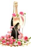 Rosafarbene Rosen und Champagner Stockfotografie