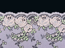 Rosafarbene Spitze mit einem Blumenmuster Lizenzfreie Stockbilder