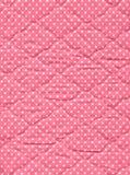 Rosafarbene Steppdecke Stockfotografie