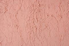 Rosafarbene Stuckwand. stockfotografie