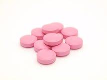 Rosafarbene Tabletten Stockbild