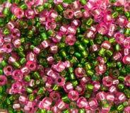 Rosafarbene und grüne Korne Stockfoto