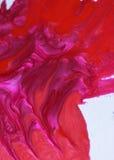 Rosafarbene und rote Nagellacktropfen Stockfotos