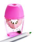Rosafarbener Bleistiftspitzer und Bleistift Stockbild