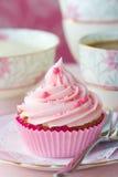 Rosafarbener kleiner Kuchen Stockfoto