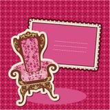Rosafarbener Lehnsessel und Abbildung auf überprüftem Hintergrund Stockfotografie