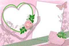 Rosafarbener Rahmen mit Rosen Lizenzfreies Stockfoto