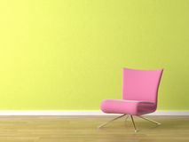 Rosafarbener Stuhl auf grüner Wand Stockbild